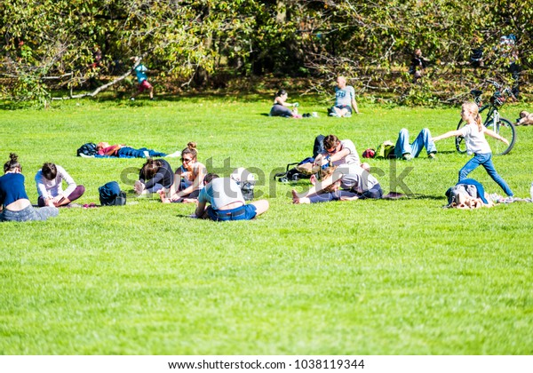 New York City, USA - October 28, 2017: Manhattan NYC Central park with many people stretching yoga exercising on great lawn grass meadow in autumn fall summer