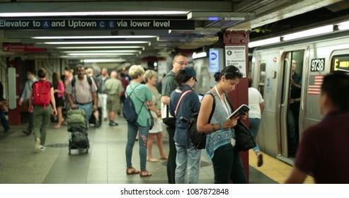 NEW YORK CITY, USA - September 20, 2017- NYC subway trains, people waiting at new york city platform