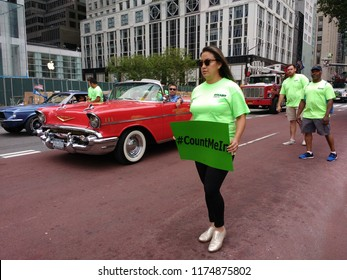 """New York City, New York / USA - September 08 2018: #CountMeIn: A woman carries a sign with the hashtag """"Count Me In"""" during the New York City Labor Day Parade."""