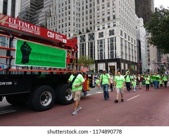 New York City, New York / USA - September 08 2018: Solidarity during the New York City Labor Day Parade.