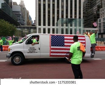 New York City, New York / USA - September 08 2018: Bricklayers and Allied Craftworkers Local Union Number One van displaying a large American flag during the New York City Labor Day Parade.