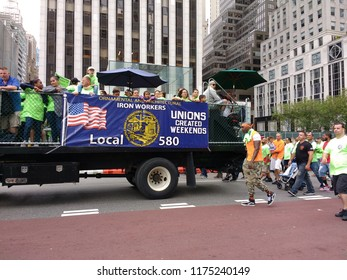 """New York City, New York / USA - September 08 2018: Ironworkers Local 580 highlights the fact that """"Unions Created Weekends"""" during the New York City Labor Day Parade."""