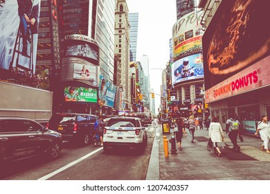 NEW YORK CITY, USA - SEPTEMBER 16, 2018: Times Square,is a busy tourist intersection of neon art and commerce and is an iconic street of New York City and America.