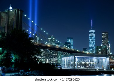 New York City, USA - September 11, 2014: Brooklyn bridge with Tribute in Light . The installation of 88 searchlights has been displayed annually in remembrance of the September 11, 2001 attacks.