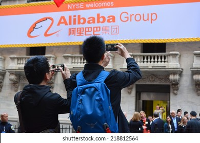 New York City, USA - September 19, 2014: People taking photos at the New York Stock Exchange marking the Initial Public Offering of the e commerce company the Alibaba Group in New York City.
