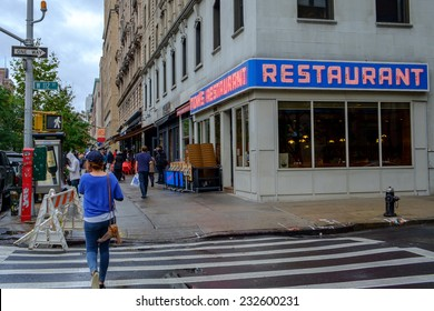 NEW YORK CITY, USA SEPTEMBER 25: Pedestrians pass Tom's Restaurant at 2880 Broadway on September 25, 2014 in NYC. This is the location for Suzanne Vegas Toms Diner and Seinfelds Monks Cafe.
