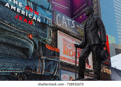 """NEW YORK CITY, USA, September 10, 2017 : Cohan's """"Give My Regards to Broadway"""" statue in Times Square. Times Square is a major commercial intersection, tourist destination and entertainment center."""