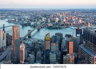 New York City, USA - September 2017: View on Manhattan and Brooklyn from the One World Trade Center late evening during sunset.