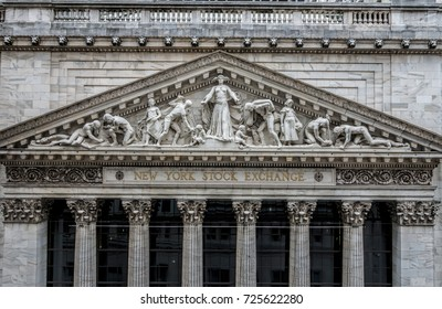 NEW YORK CITY, USA, September 30, 2017 : Closeup of the limestone pediment on the facade of the world famous New York Stock Exchange building on Wall Street, sculpted by John Quincy Adams Ward in 1904