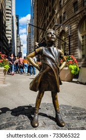 """New York City, USA - September 29, 2017: """"The Fearless Girl"""" statue in Lower Manhattan constructed to honor International Women's Day in New York City."""