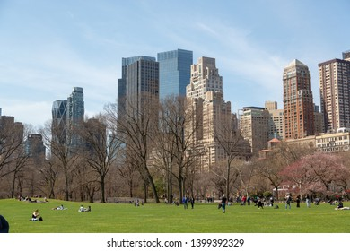 New York City, New York / USA United States - 04 08 2019: Central Park in New York City in spring, May. View of skyscrapers of Midtown from Sheep' s Meadow