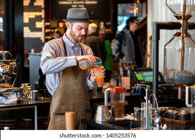 New York City, New York / USA United States - 04 08 2019: Starbucks Reserve Roastery cafe in Chelsea, NYC. Coffee barista making unique coffee items.