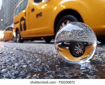 New York City yellow taxi cab with lens ball
