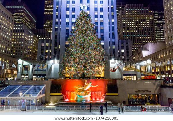 New York City, New York/United States - January 7, 2015: A brightly illuminated Rockefeller Plaza with a Christmas tree.