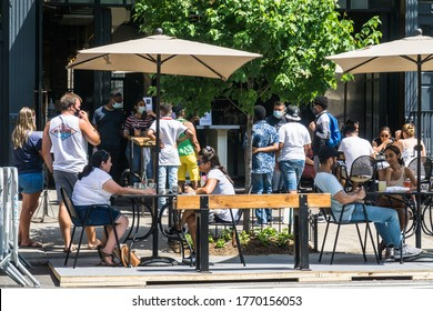 New York City, New York/USA July 5, 2020 Restaurants setup outside dining area and continue to practice social distancing after being shutdown during the coronavirus pandemic.