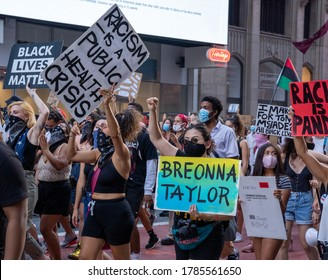 New York City, New York/USA - July 26th, 2020 Black Womens/Womxn March Black Lives Matter Protest - Breonna Taylor sign and Racism is a public health crisis
