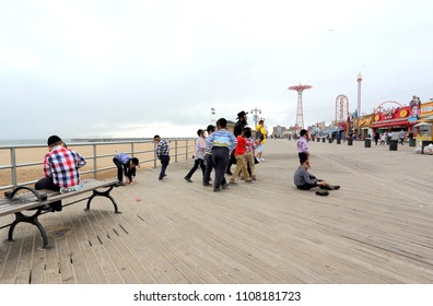 New York City,Coney Island,USA. 05/10/2018.The Beach & Boardwalk is well known as the site of amusement parks and a seaside resort, in an overcast day, with a group of orthodox Jewish  children.