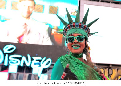 New York City,Manhattan,USA. 05.12.2018. Girl dressed in green as a costumed character of Miss Liberty,as a symbol of freedom, in the pedestrian plazas of Times Square,Broadway.