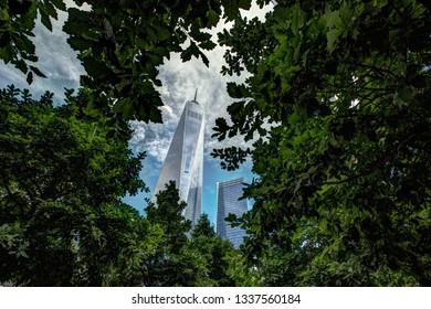 New York City/NY/USA - June 2015: One World Trade Center behind trees at Ground Zero