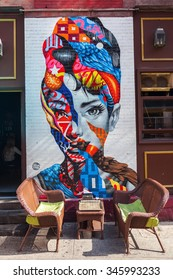 NEW YORK CITY-OCTOBER 09, 2015: Audrey Hepburn mural with unidentified people. Its part of the L.I.S.A Project that brings artists together in Little Italy creating Manhattans only mural arts district