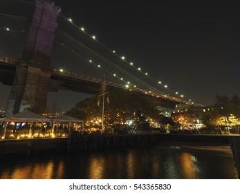 New York City's Brooklyn Bridge and Manhattan skyline illuminated at night