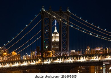 New York cityscape with Manhattan Bridge framing Empire State Building
