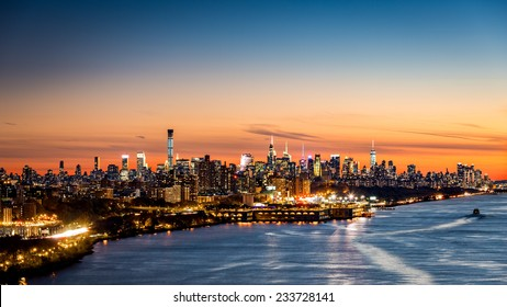 New York cityscape at sunset as viewed from George Washington Bridge