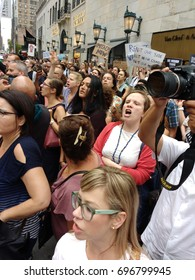 New York City/USA August 14 2017: Protesters chant anti-Trump sentiments while awaiting the arrival of President Donald Trump.