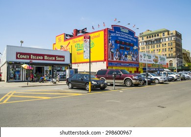 NEW YORK CITY,USA -AUGUST 6,2013:view of buildings in Coney Island amusement park and people that walking during a sunny day.