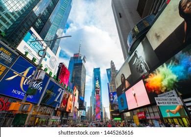 New York City/USA - May 24, 2019 Times Square, an Iconic Street in New York City. Street View, Neon Art, Billboards, and Tourists.