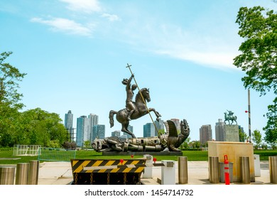 New York City/USA - May 25, 2019 UN Gift Garden, Good Defeats Evil Statue Outside the United Nations Building, 1St Avenue, NYC