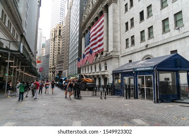 New York City/USA - September 2, 2019: Street View Of The New York Stock Exchange With Security Booth And American Flag In Financial District Of Lower Manhattan.