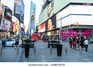 New York City/USA - September 3, 2019: At The Junction Of Broadway And Seventh Avenue, Times Square Is A Major Commercial Intersection In Midtown Manhattan Filled With Electronic Billboards And Signs.