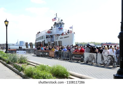 New York City,USA,05.07.2018. Tourists queuing to Miss Liberty boat in Battery Park.Statue Cruises is the only ferry provider authorized to take visitors to the Statue of Liberty and Ellis Islands.