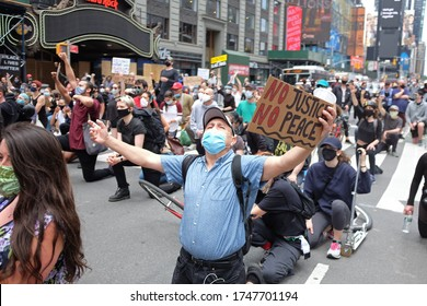 New York City/USA-June 2 2020: marchers protesting racism pause in Times Square to measure the 8 minutes George Floyd's neck was pressed under the knee of a Minneapolis police officer