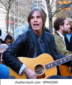 NEW YORK - DEC 1: Musician Jackson Browne performs in Zuccotti Park, Lower Manhattan, on December 1, 2011 in New York City. Browne was there to play music in support of the Occupy Wall Street protest.