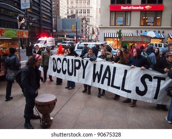 NEW YORK - DEC 12: Unidentified Occupy Wall Street protesters march to protest Goldman Sachs on December 12, 2011 in New York City, NY.  Protests against the financial system took place nationwide.