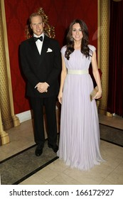 NEW YORK - Dec 6: Wax figures of Prince William and Kate Middleton are seen on display at Madame Tussauds on December 6, 2013 in New York City.