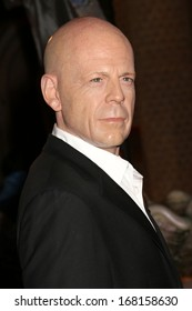 NEW YORK - Dec 6: A wax figure of Bruce Willis is seen on display at Madame Tussauds on December 6, 2013 in New York City.