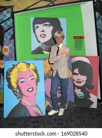 NEW YORK - Dec 6: A wax figure of Andy Warhol is seen on display at Madame Tussauds on December 6, 2013 in New York City.