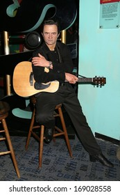 NEW YORK - Dec 6: A wax figure of Johnny Cash is seen on display at Madame Tussauds on December 6, 2013 in New York City.