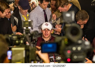NEW YORK - DEC 7:  Front runner Johnny Manziel mobbed by journalists at the 2012 Heisman Trophy press conference at Marriott Marquis in New York City on December 7, 2012.