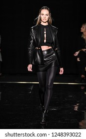 NEW YORK, NEW YORK - DECEMBER 02: Candice Swanepoel walks the runway at the Versace Pre-Fall 2019 Collection at The American Stock Exchange on December 02, 2018 in New York City.