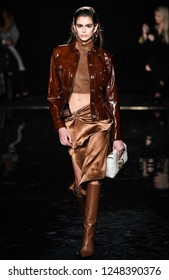NEW YORK, NEW YORK - DECEMBER 02: Kaia Gerber walks the runway at the Versace Pre-Fall 2019 Collection at The American Stock Exchange on December 02, 2018 in New York City.