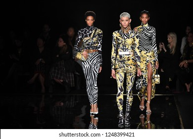 NEW YORK, NEW YORK - DECEMBER 02: Models walk the runway at the Versace Pre-Fall 2019 Collection at The American Stock Exchange on December 02, 2018 in New York City.