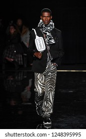 NEW YORK, NEW YORK - DECEMBER 02: Salomon Diaz walks the runway at the Versace Pre-Fall 2019 Collection at The American Stock Exchange on December 02, 2018 in New York City.