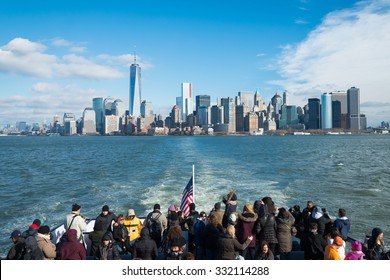 NEW YORK - December 08: Cruise yacht with Manhattan skyline with the group of people on December 08, 2013.