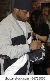 NEW YORK - DECEMBER 1 - Rapper Freekey Zekey signs hats at the New Era launch party for Johnny Nunez Limited Edition 59FIFTY CAP at the New Era Flagship store in New York on December 1, 2010.