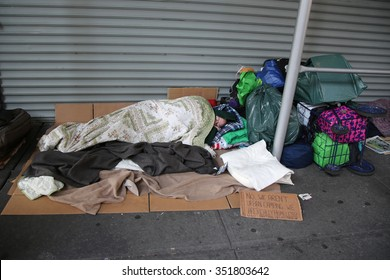 NEW YORK - DECEMBER 13, 2015: Scene at Times Square in Midtown Manhattan.Times Square is a major commercial intersection and a neighborhood in Midtown Manhattan. Homeless person