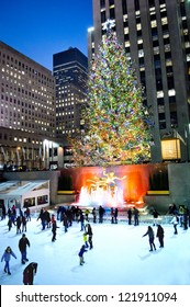 NEW YORK - DECEMBER 14: Ice skaters enjoy the rink around the famous Rockefeller Center Christmas tree at night on December 14, 2012 in New York City.